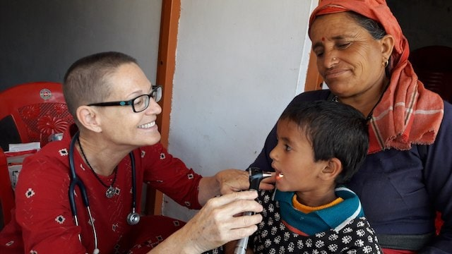 Dr Gina Jansheski performing medical checks on a child in India